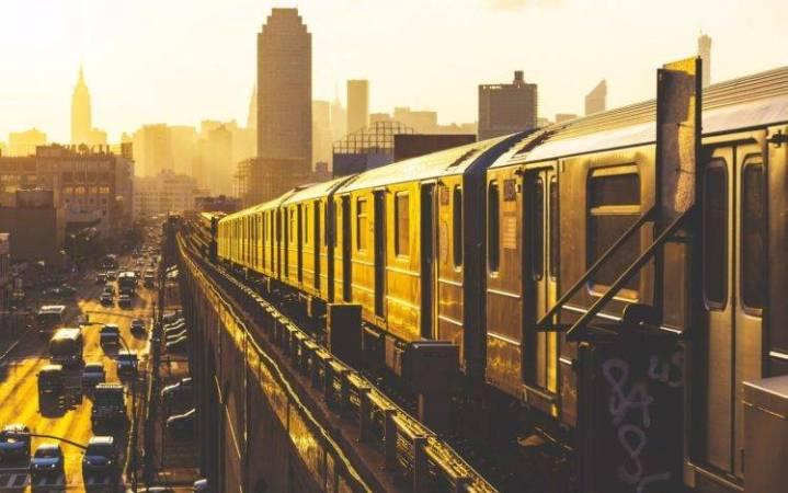 447035-cityscape-city-trucks-buses-car-road-morning-skyscraper-railway-metro-sunlight-748x468