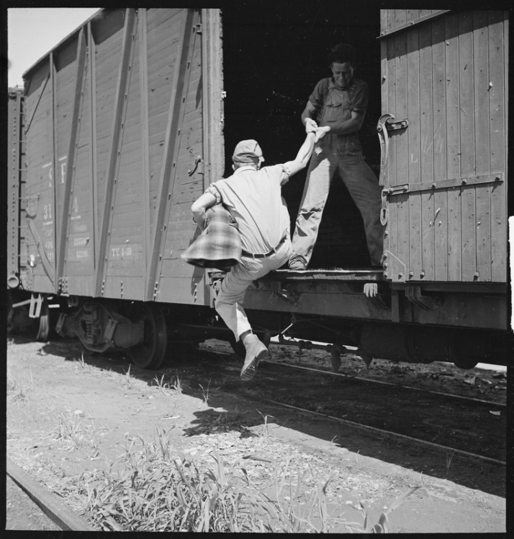 Bakersfield,_California._On_the_Freights._Helping_a_newcomer_hop_a_freight_-_NARA_-_532069.tif.jpg