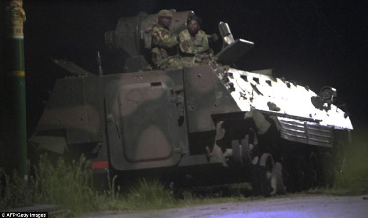 465C775800000578-5081687-Two_soldiers_sitting_in_a_tank_on_the_outskirts_of_Harare_where_-a-23_1510732571291.jpg
