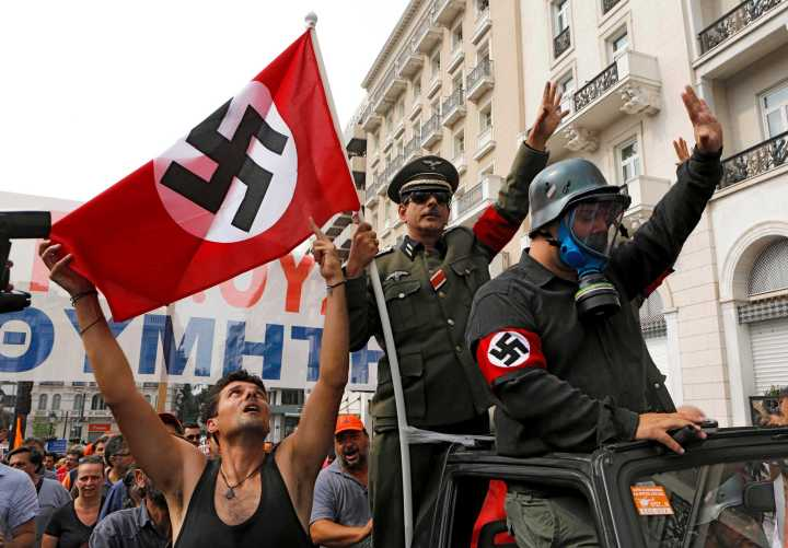 demonstrators-dressed-as-nazis-wave-a-swastika-data