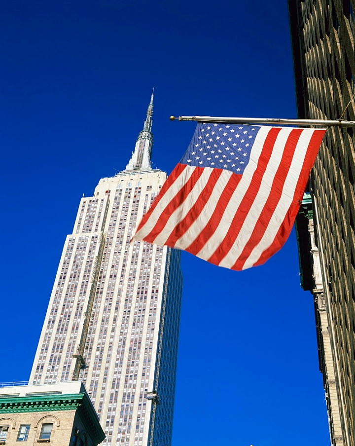 The American flag, the stars and stripes in front of the Empire State Building in New York, United States of America, North America