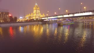 frozen-moscow-river-cruise-ship-icebreaker-ukraine-hotel-at-background-night-evening-illumination-unique-aerial-drone-4k-footage-in-the-center-of-capital-of-russia-snow-winter_sjzab6stx_