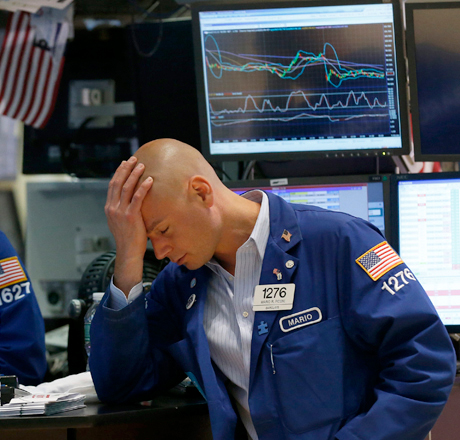 File photo of trader Mario Picone working on the floor of the New York Stock Exchange